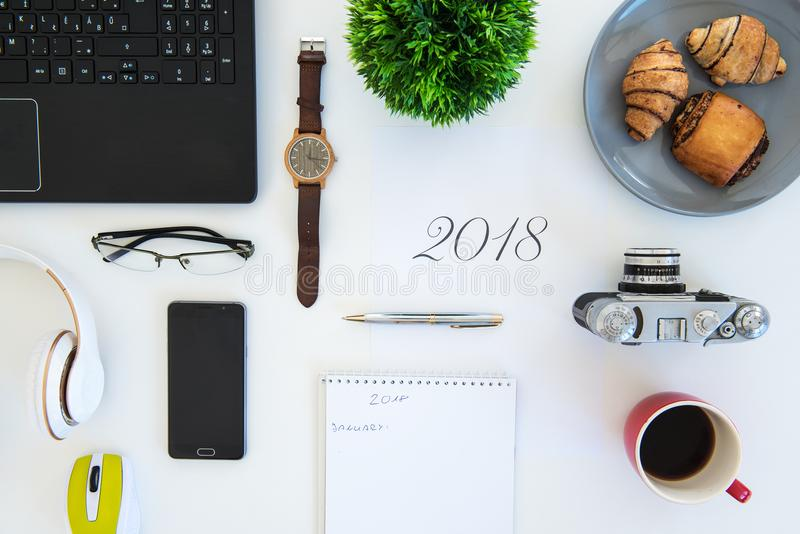 High angle shot of items on a table at an office workstation stock photography