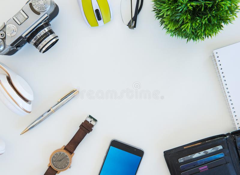 High angle shot of items on a table at an office workstation stock images