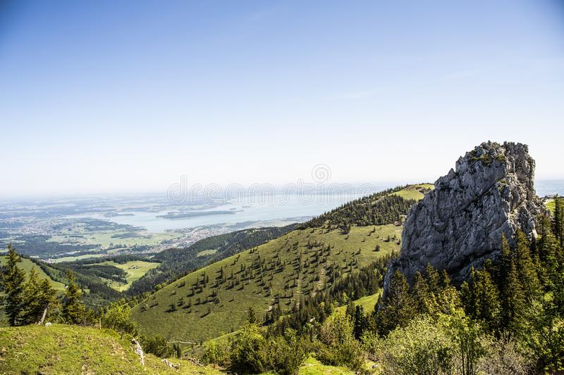 High angle shot of Kampenwand mountains in Chiemsee, Bavaria under the beautiful blue sky stock photography