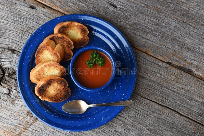 High angle shot of a mug of fresh homemade tomato soup with garlic toast royalty free stock photography