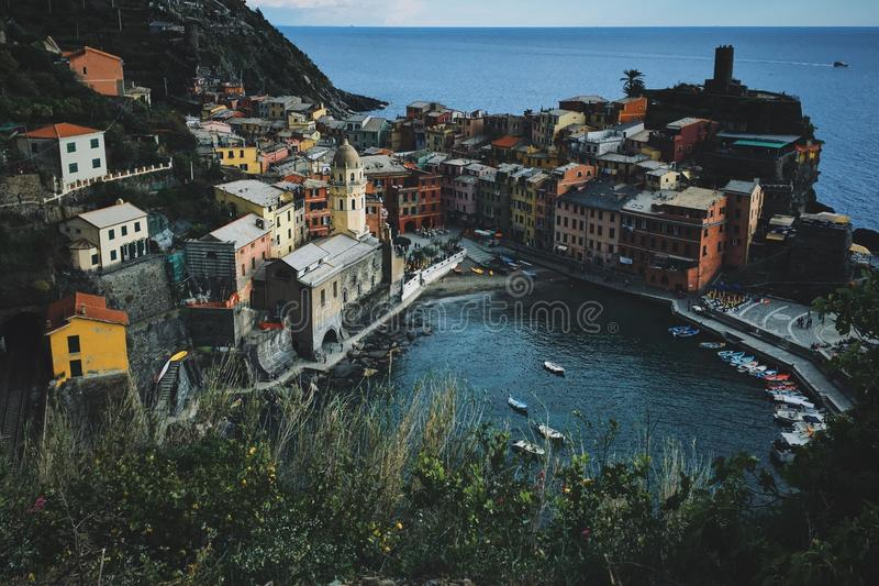 High angle shot of pond with boats near the building in Vernazza royalty free stock image