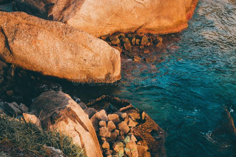 High angle shot of rock formations and details of beautiful colors on a beach in Niteroi royalty free stock photography
