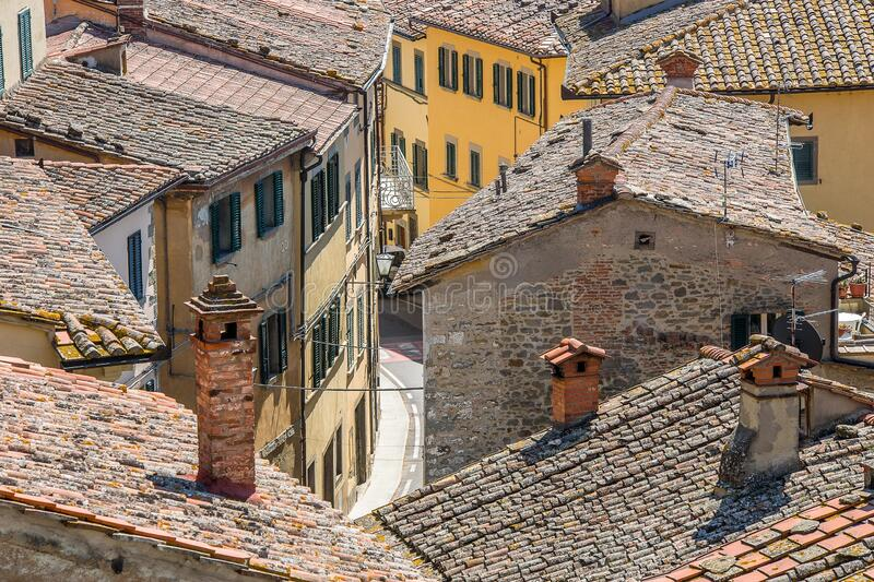 High angle shot of the roofs of the beautiful village houses on an alley. A high angle shot of the roofs of the beautiful village houses on an alley royalty free stock photo
