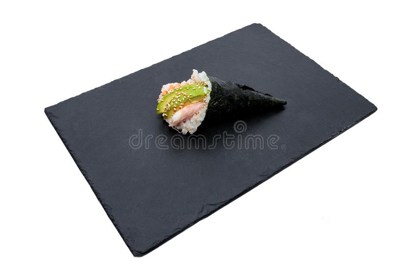 High angle shot of a sashimi sushi roll on a black tray isolated on a white background stock photo