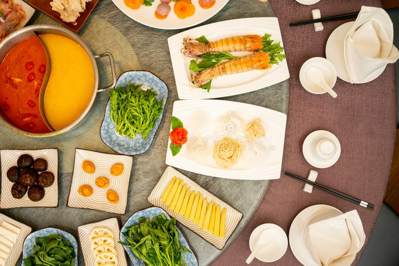 High angle shot of a side dishes around a soup on an oriental table stock image
