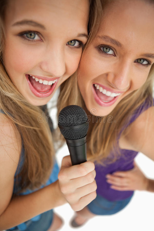 Download High-angle Shot Of Two Happy Young Beauty Singing Stock Photo - Image: 25335490