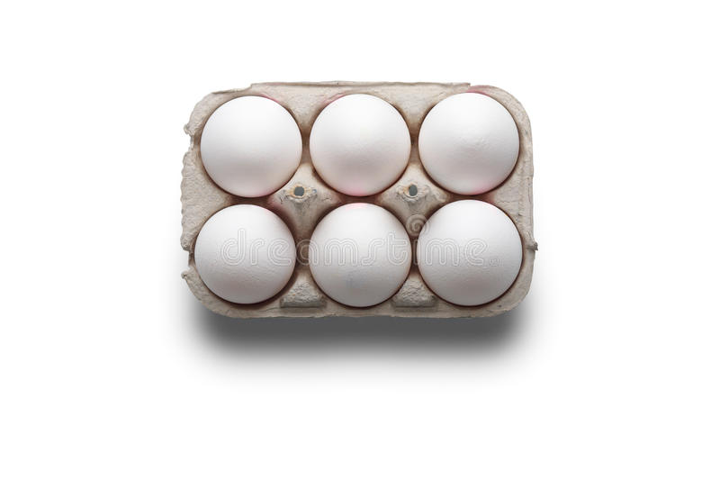 High angle studio shot of six white eggs in a box. On white background stock photo