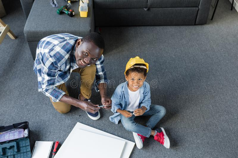 high angle view of adorable african-american father and son stock image