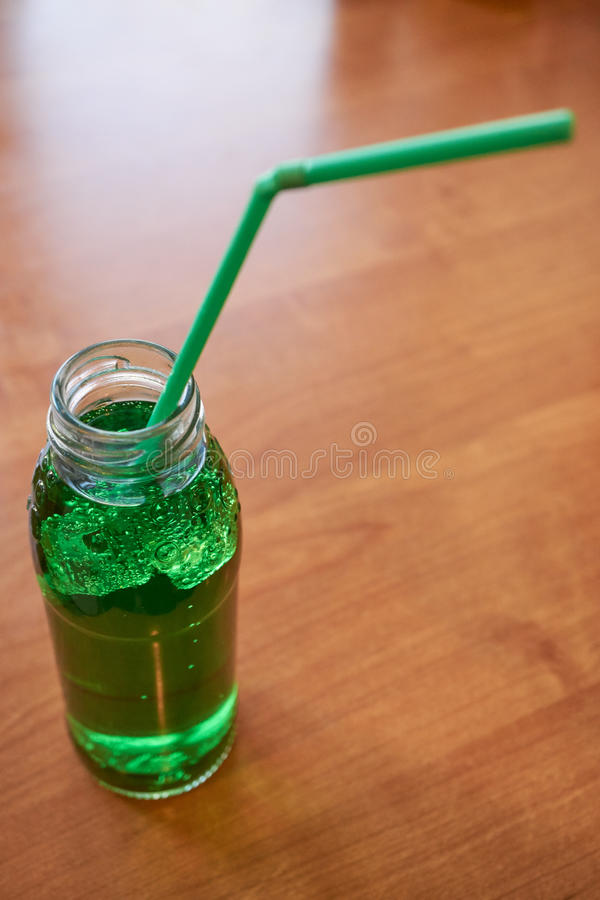 High angle view of aerated water bottle. With drinking straw on a desk royalty free stock photo
