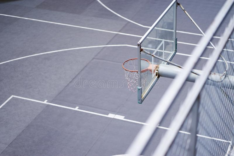 High angle view of basketball hoop in outdoor court nobody. High angle view of basketball hoop standing in outdoor court nobody royalty free stock photos