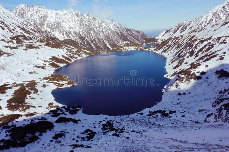 High-angle View of Body of Water in Between Snow-covered Mountain Range stock image