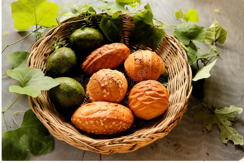 Top view of Bread and avocado in basket decorate by gourd leaf royalty free stock image