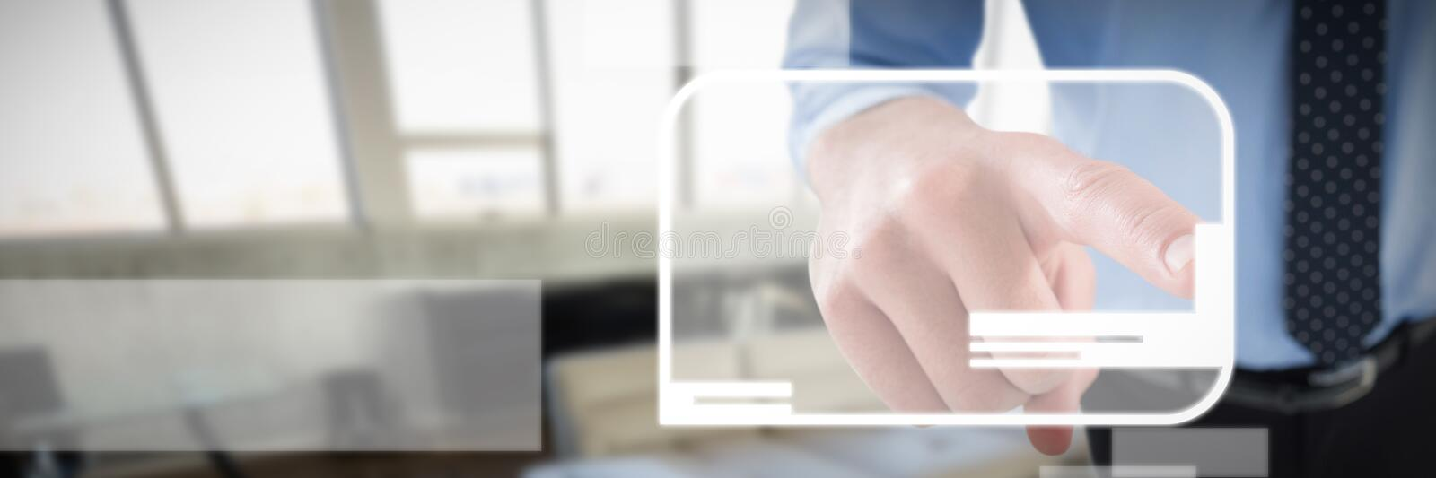 High angle view of businessman using imaginary screen against high angle interior of modern office stock image