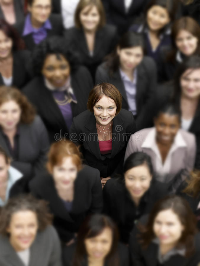 High angle view of a businesswoman standing amidst multiethnic businesspeople stock photos