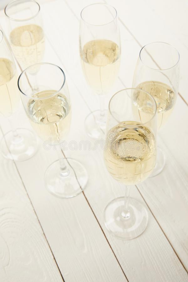 high angle view of champagne glasses on white wooden table royalty free stock photos