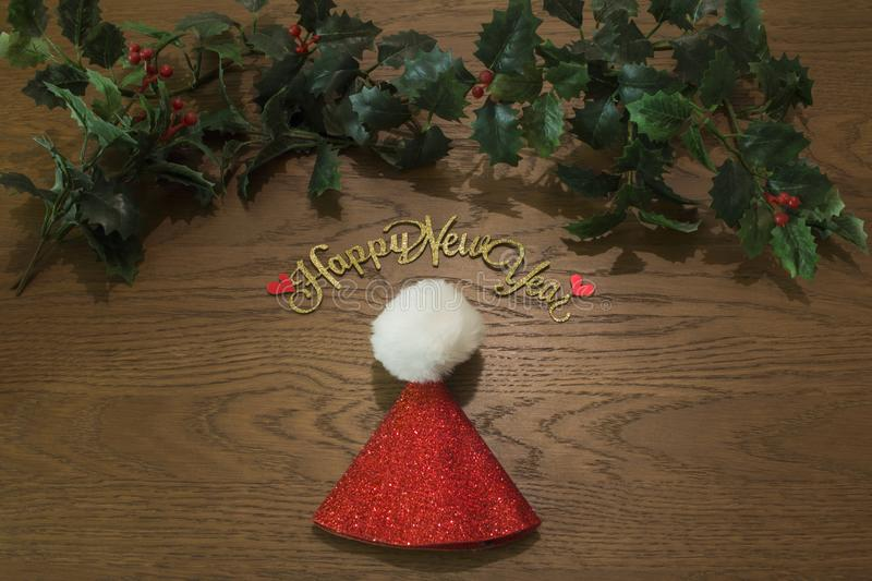 High angle view of christmas decorations on wooden background stock photography