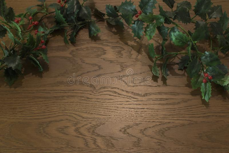 High angle view of christmas decorations on wooden background stock photo
