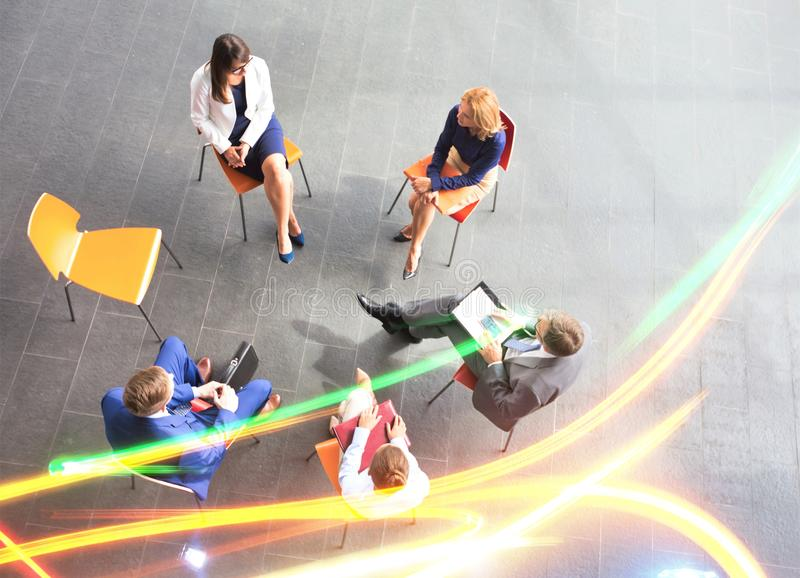 High angle view of colleagues planning while sitting during meeting at office stock image
