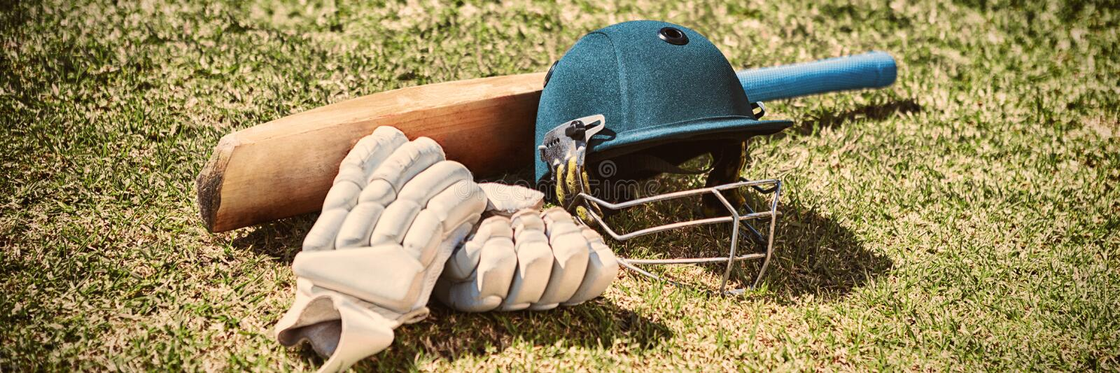 High angle view of cricket equipment on field royalty free stock photo