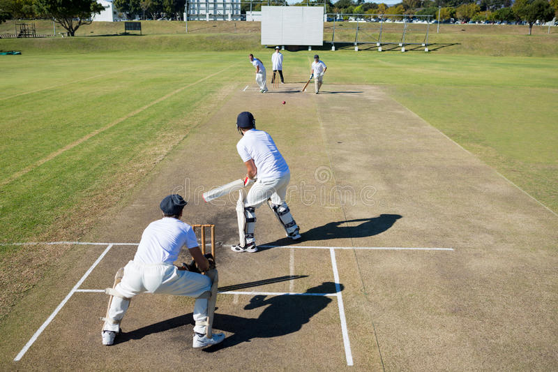 High angle view of cricket match at field stock photography