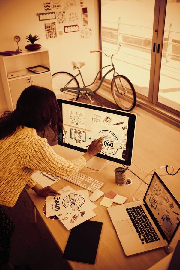 Female graphic designer working in creative office. High angle view of female graphic designer working in creative office stock photos