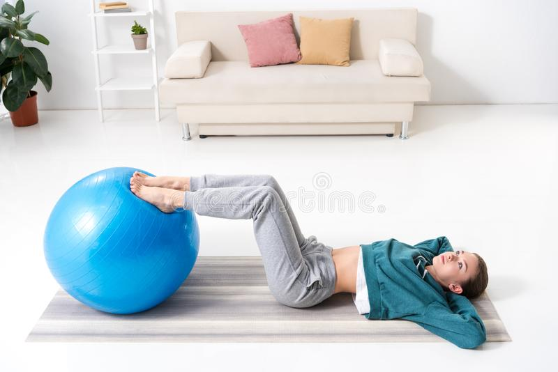high angle view of girl exercising at home with legs royalty free stock photos