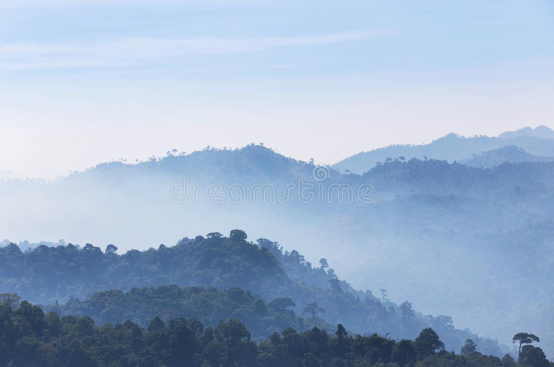High angle view of layer tropical mountains with white fog. In Thailand royalty free stock image