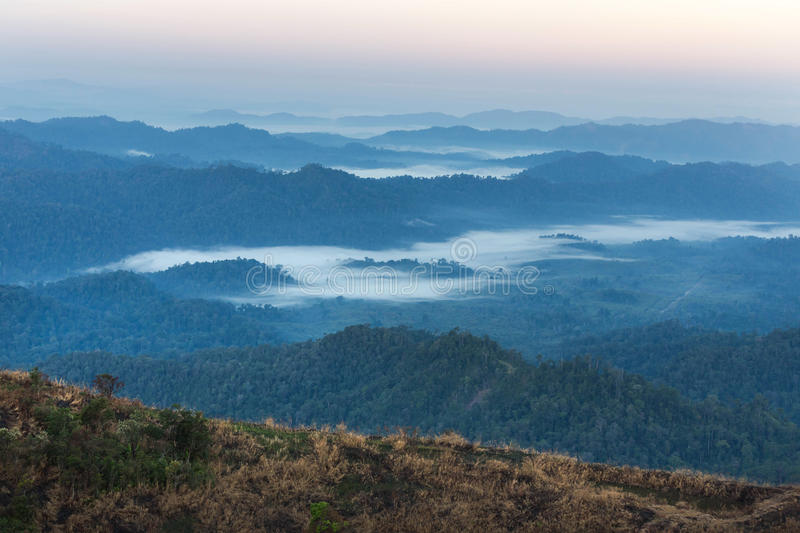High angle view of layer tropical mountains with white fog. In Thailand royalty free stock photo