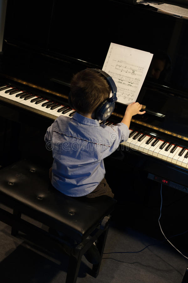 High angle view of a little boy learning piano. Color image, canon 5DmkII royalty free stock photography
