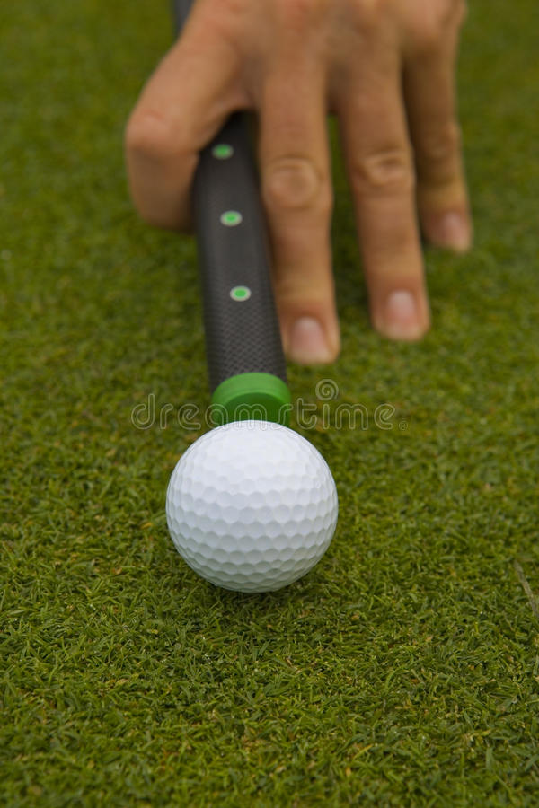 High angle view of a man`s hand aiming a golf ball stock image