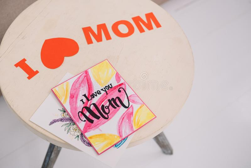 High angle view of mothers day greeting cards lying. On table stock photos