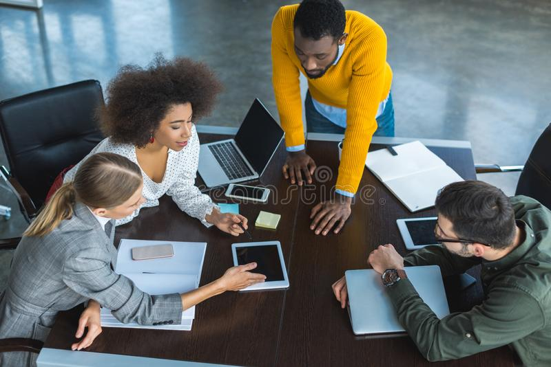 high angle view of multicultural businesspeople at discussion royalty free stock image