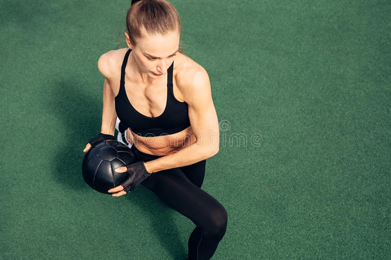 High angle view of a muscular woman exercising royalty free stock photo