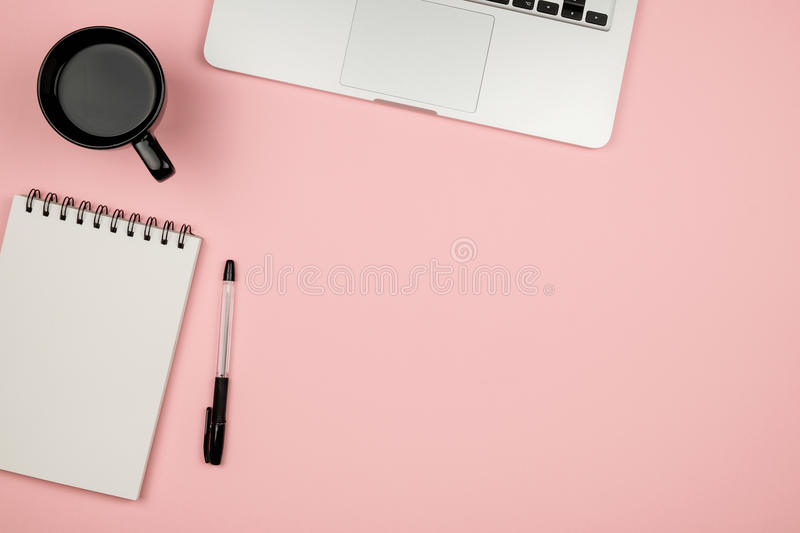 High angle view of office colored desk with copy space. Table with laptop and supplies. Top view. Flat lay. Freelancer or student desk stock images