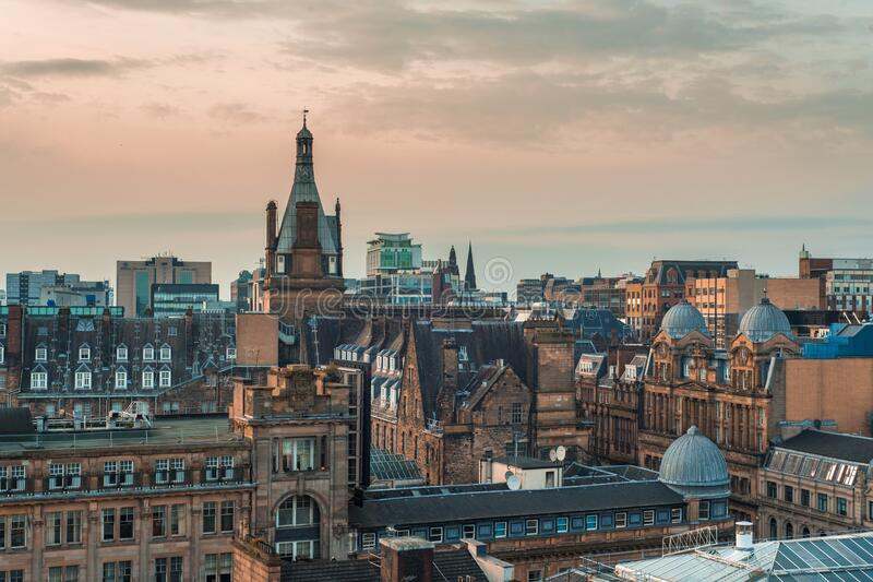 A high angle view of old and new buildings at sunset in Glasgow, Scotland. A high angle view of old and new buildings at sunset in Glasgow city centre, Scotland stock photography