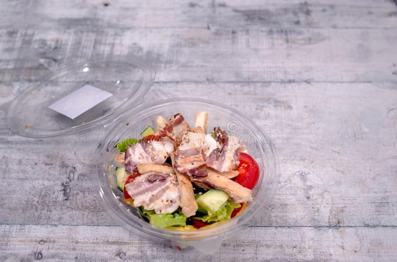High angle view of opened bowl full of salad. With meat and lettuce stock images