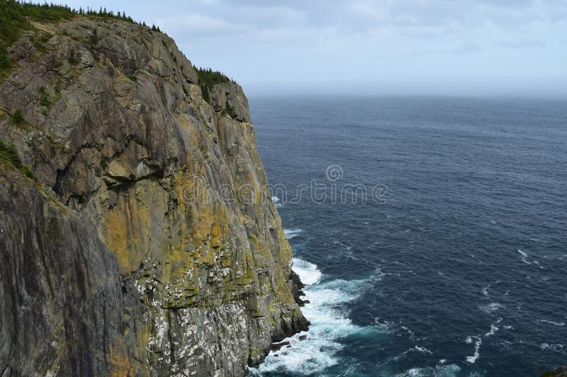 High angle view past a cliff towards the ocean royalty free stock image
