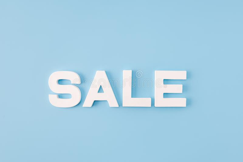 High angle view photo of big sale word announce final season discounts white letters advising client visit shopping mall. High angle view photo of big sale word stock photo