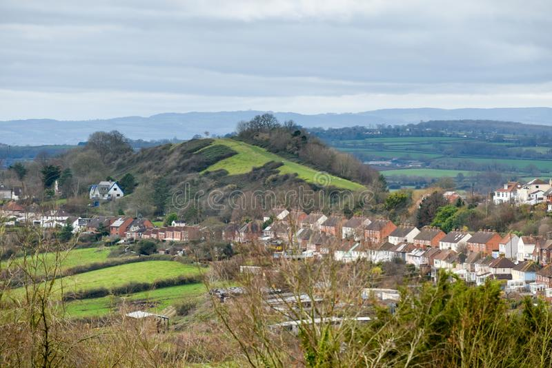High angle view of scenery with small english town or village in the countryside with hills and fields royalty free stock images