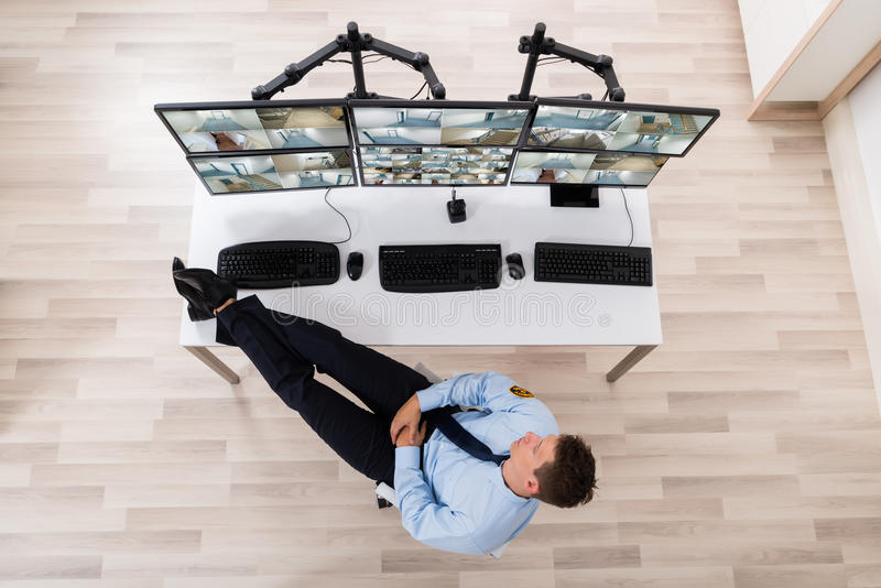 Security Guard Sleeping In Office royalty free stock photography