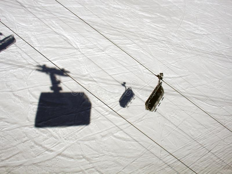 A high angle view of a shadow of a ski lift cabin in the alps switzerland.  royalty free stock image