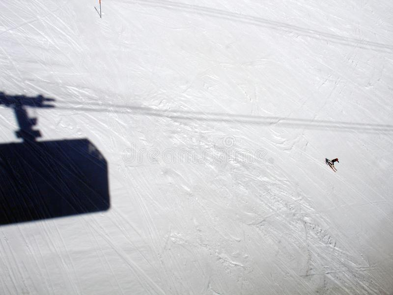 A high angle view of a shadow of a ski lift cabin in the alps switzerland.  royalty free stock photo