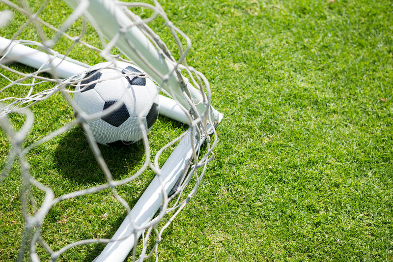 High angle view of soccer ball by goal post stock photos