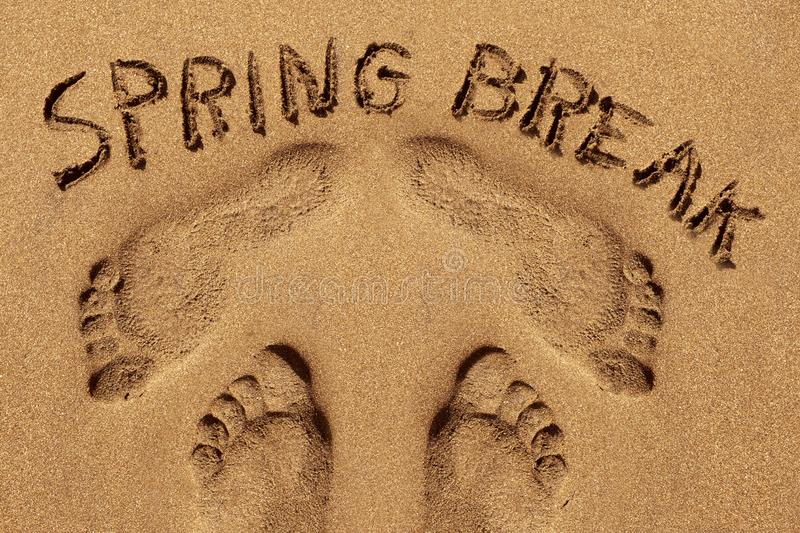Text spring break in the sand of a beach royalty free stock photography