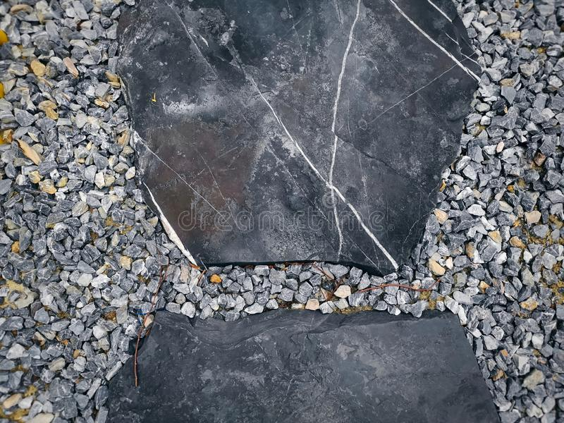 High Angle View of Stone Pavement Blocks on Small Gravel Stones stock photos