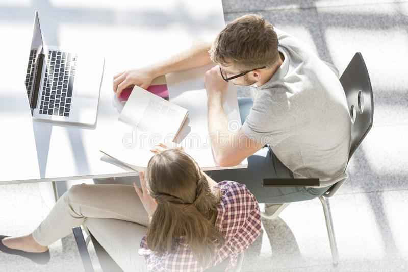 High angle view of students working on assignment at library royalty free stock photography