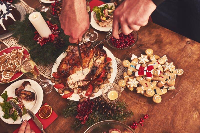 High angle view of table served for Christmas family dinner. Tab. High angle view of table served for Christmas family dinner royalty free stock photography