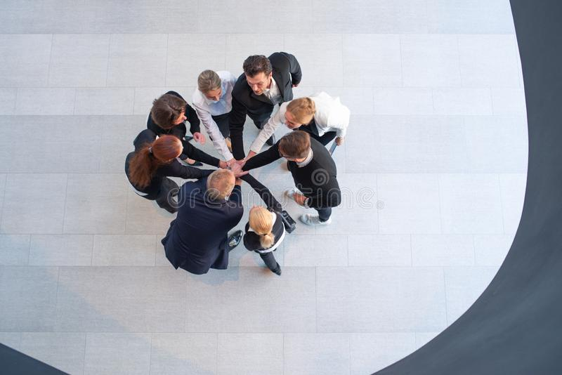 Businesspeople with their hands together stock images