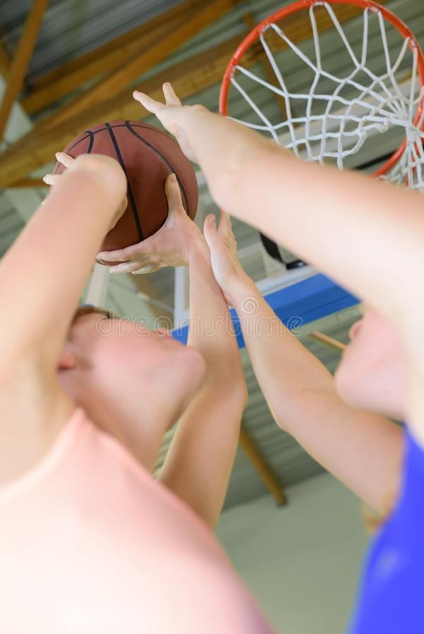 High angle view three young men playing basketball. High angle view of three young men playing basketball royalty free stock images