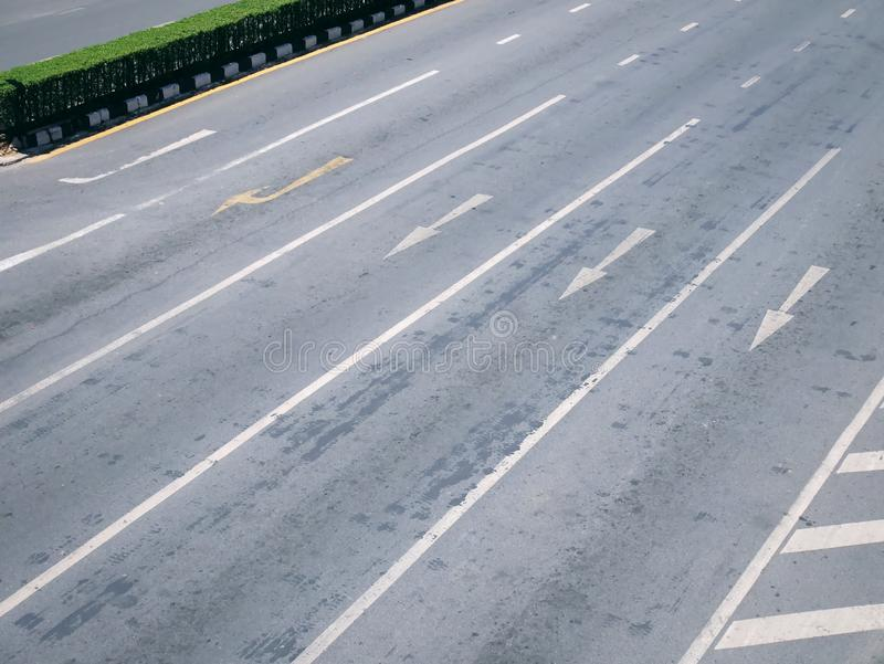 High Angle View of Traffic Arrows of Go Straight and Turn Right on Multiple Lanes royalty free stock images